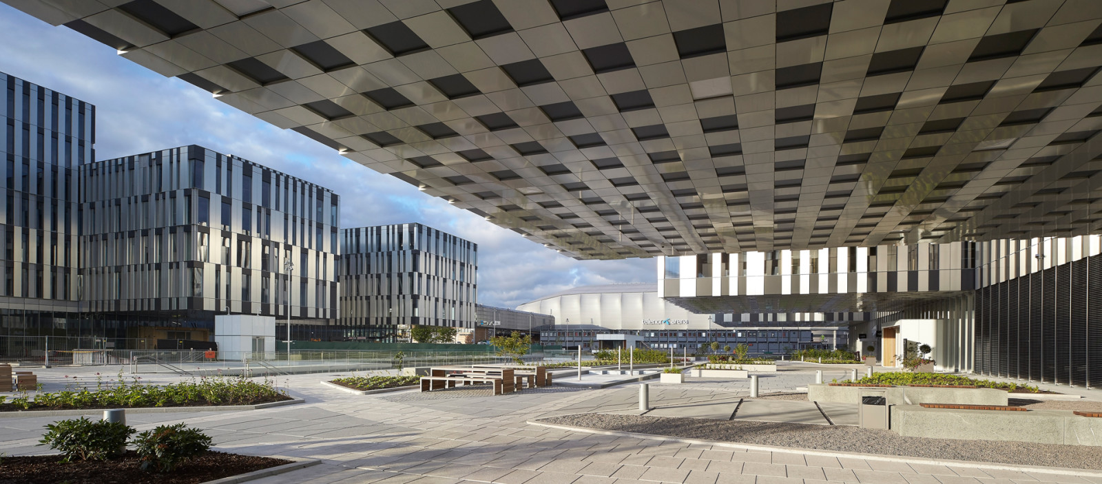 Fornebuporten, Fornebu, Oslo, Dark, Arkitekter, Architects, Arkitektur, Architecture, Design, Zinc, Bærum, office, retail, mixed-use, commercial, cantilever, urban space, urban design, square, torg, fasade, facade, ceiling