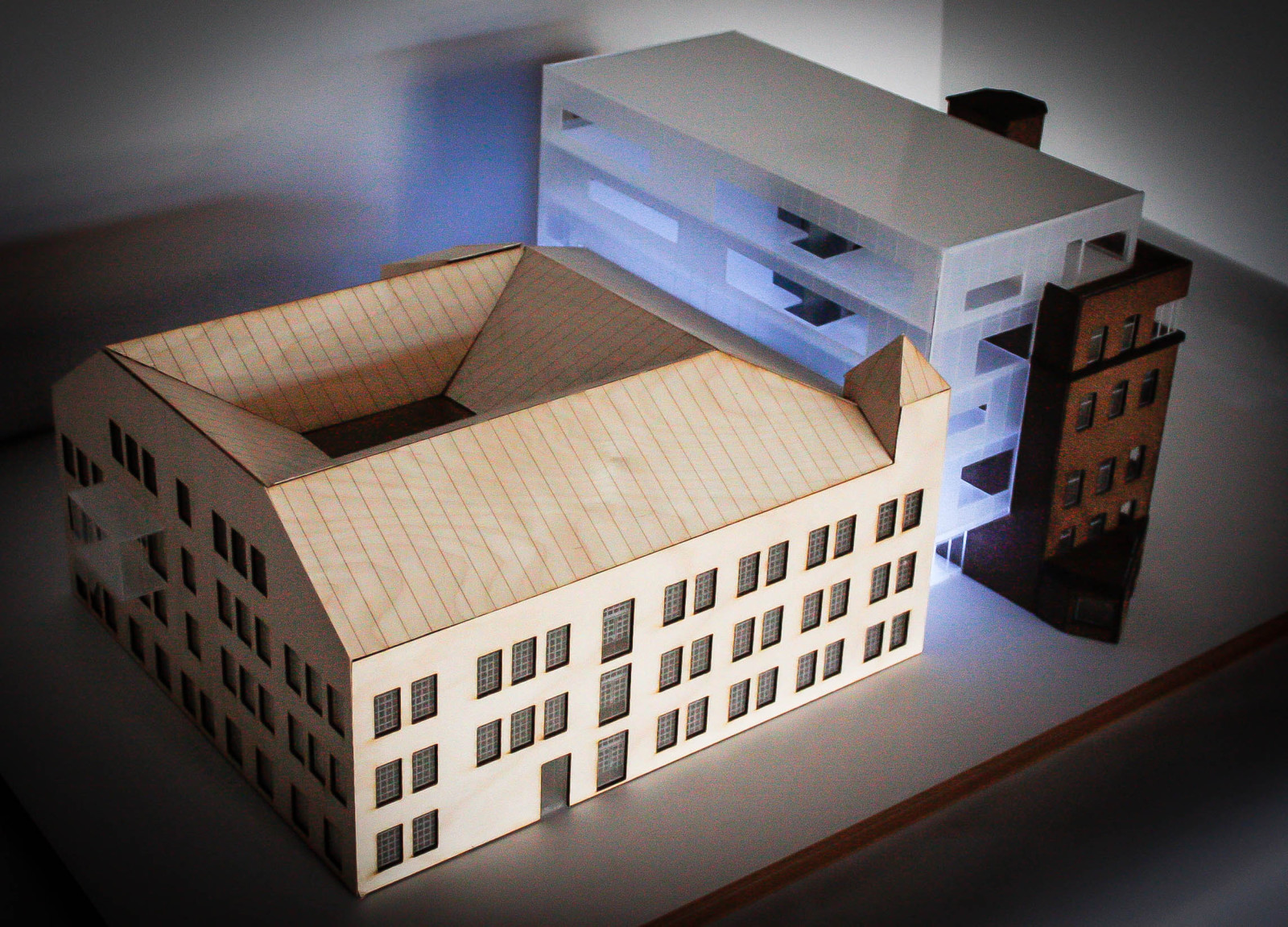 Model. Two existing volumes are linked by a glazed building.